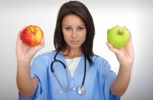 female-doctor-holding-two-apples